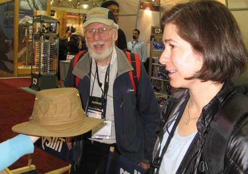 Alicia and Bill admire a Tilley hat