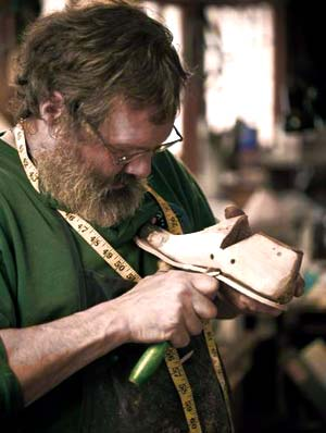 Peter Limmer adjusting a custom boot last.