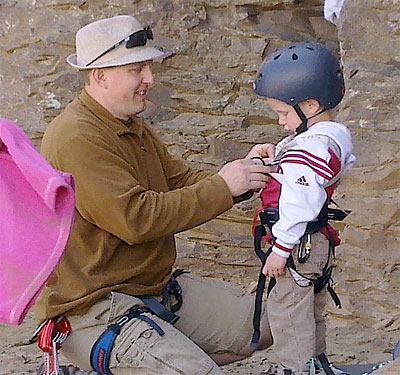 Jeff gearing up his 4 year old for his first rock climb, Frenchman Coulee, WA