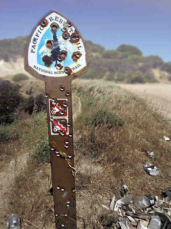 Shot-up PCT trail sign.